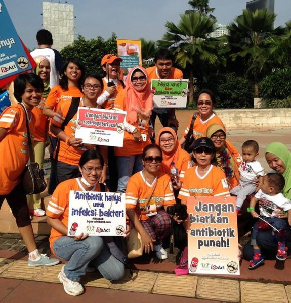 Participants with message boards in a walk to raise awareness about smart use of antibiotics in Jakarta, Indonesia.