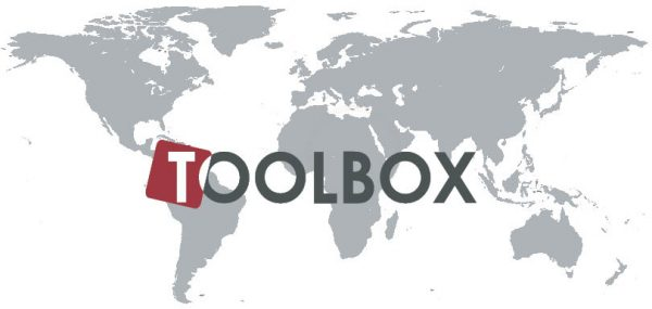 Toolbox logo with grey world map in the background