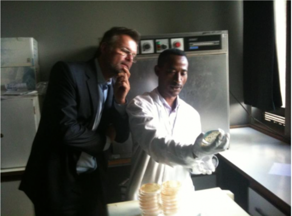 Two people looking at samples in a lab