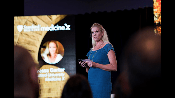 Woman-on-stage-speaking