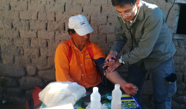 Víctor-Orellana-at-work-as-a-health-care-worker-in-a-small-village-in-Argentina.Here-with-a-patient