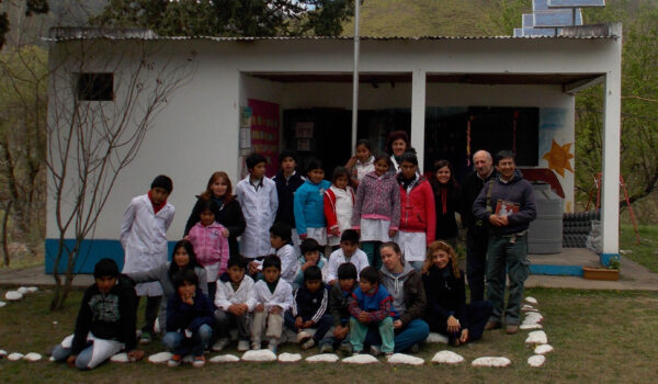 As a health care worke,r Víctor Orellana works close to the local community. Here with the young schoolchildren at the only school in the village.